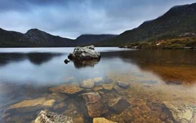 Australia Tasmania Cradle Mountain and DOve Lake national park bottom of the lake transparent pure water and stones within still reflection